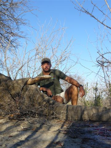 Henry Griffiths with problem elephant hunted in Botswana